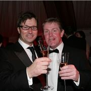 Knees up! Michael Hanlon, boss of the Maghull Group with Council leader Warren Bradley