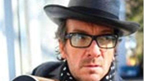 Elvis Costello gives guitar for raffle