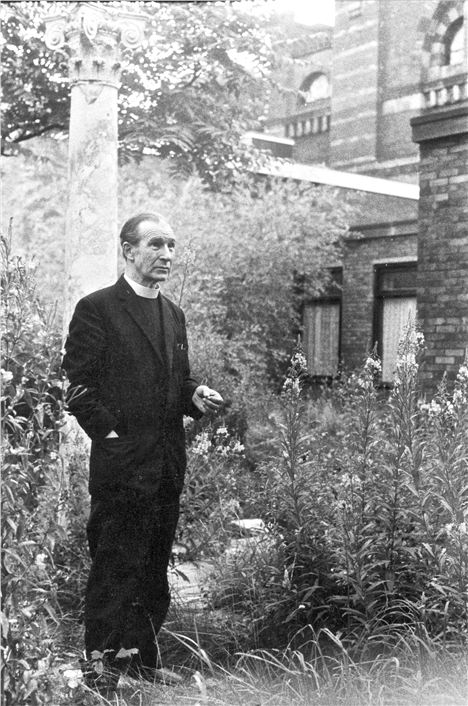 Father Crowley In The Overgrown Garden At St Philip Neri Church 1972 %26#169%3BTricia Porter